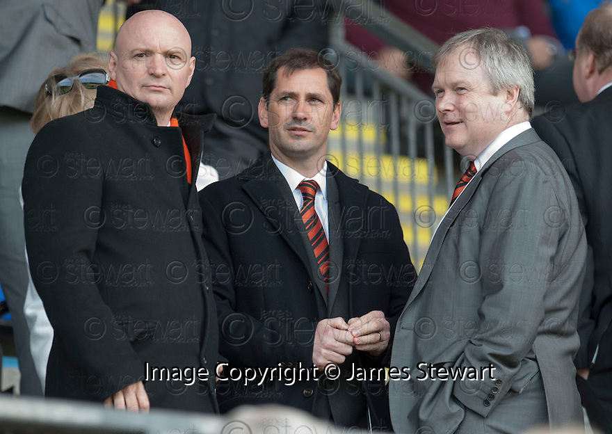 Dundee Utd manager Jackie McNamara takes his seat in the stand.