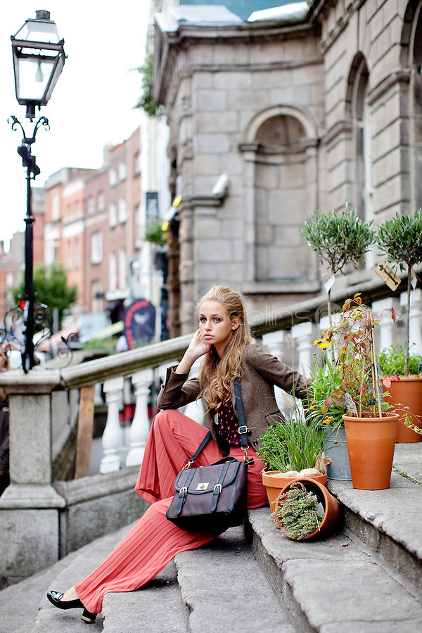 NO REPRO FEE. 31/8/2011. A wear's new autumn '11 collection. Sarah Morrissey & Thalia Heffernan model a selection of dresses at the Powerscourt Town House Dublin. Thalia is pictured wearing Paisley frill top - EUR35, Pleated palazzo pant -EUR50, Heritage blazer - EUR60,Brown satchel - EUR30 and Belt - EUR8. The full range is available in all A wear stores and online at www.awear.com now. Picture James Horan/Collins Photos