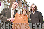 CARVING: Gerry Baynham from Castlemaine presents his wood carving image of explorer, Tom Crean to the staff of the County Museum in Tralee including Helen O'Carroll and Griffin Murray.