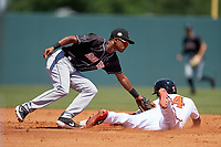 Jupiter Hammerheads shortstop Jose Devers (1) looks to tag Shean Michel (14) sliding in during a Florida State League game against the Florida Fire Frogs on April 11, 2019 at Osceola County Stadium in Kissimmee, Florida.  Jupiter defeated Florida 2-0.  (Mike Janes/Four Seam Images)