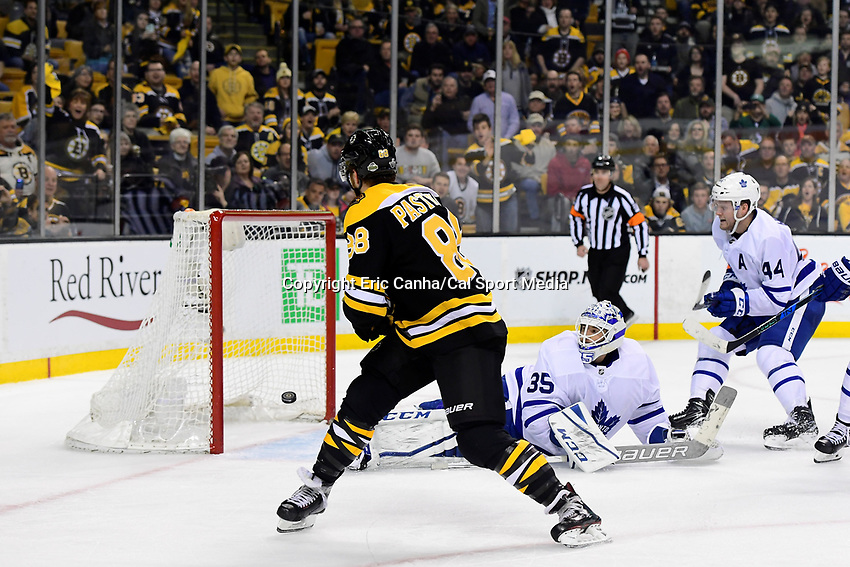 April 14, 2018: Boston Bruins right wing David Pastrnak (88) flips the puck backhanded for his third goal of the night as Toronto Maple Leafs goaltender Curtis McElhinney (35) watches it sail by during game two of the first round of the National Hockey League's Eastern Conference Stanley Cup playoffs between the Toronto Maple Leafs and the Boston Bruins held at TD Garden, in Boston, Mass. Boston defeats Toronto 7-3. Eric Canha/CSM