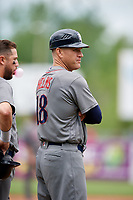 Lehigh Valley IronPigs bench coach Wes Helms (18) stands next to Trevor Plouffe (19) during a game against the Syracuse Chiefs on May 20, 2018 at NBT Bank Stadium in Syracuse, New York.  Lehigh Valley defeated Syracuse 5-2.  (Mike Janes/Four Seam Images)