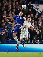 John Terry of Chelsea goes up against Hector Herrera of FC Porto during the UEFA Champions League group G match between Chelsea and FC Porto at Stamford Bridge, London, England on 9 December 2015. Photo by Andy Rowland.