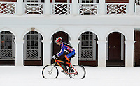 A cyclist rides on the lawn area at the University of Virginia Thursday after a snowfall in Charlottesville, VA. Photo/Andrew Shurtleff