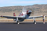The 2008, 2009, & 2010 Gold Unlimited Champion 'Strega,' owned by Bill 'Tiger' Destafani and piloted by Steve Hinton does an engine run on the ramp at Stead Field Nevada. In 2010 Strega, a modified North American Aviation P-51D Mustang powered by a Rolls Royce Merlin engine, finished 1st for the ninth time in its illustrious career.