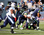 Seattle Seahawks quarterback Russell Wilson is hauled down by  Tennessee Titians defensive end Kameron Wimbley at CenturyLink Field in Seattle, Washington on  October 13, 2013. The Seattle Seahawks beat the Titians  20-13.   ©2013. Jim Bryant Photo. All Rights Reserved.