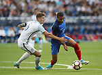 France's Kylian Mbappe tussles with England's John Stones during the Friendly match at Stade De France Stadium, Paris Picture date 13th June 2017. Picture credit should read: David Klein/Sportimage
