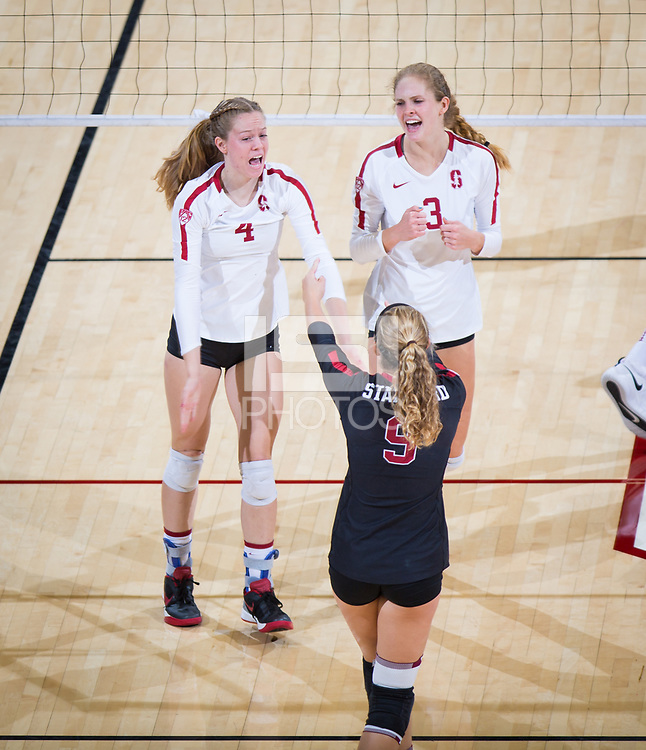 STANFORD, CA - October 12, 2018: Meghan McClure, Holly Campbell, Morgan Hentz at Maples Pavilion. No. 2 Stanford Cardinal swept No. 21 Washington State Cougars, 25-15, 30-28, 25-12.