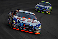 Apr 22, 2006; Phoenix, AZ, USA; Nascar Nextel Cup driver Mark Martin of the (6) AAA Ford Fusion leads Jimmy Johnson during the Subway Fresh 500 at Phoenix International Raceway. Mandatory Credit: Mark J. Rebilas-US PRESSWIRE Copyright © 2006 Mark J. Rebilas..