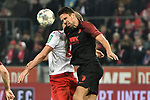 30.11.2019, Rheinenergiestadion, Köln, GER, DFL, 1. BL, 1. FC Koeln vs FC Augsburg, DFL regulations prohibit any use of photographs as image sequences and/or quasi-video<br /> <br /> im Bild Kopfball / Kopfballduell Simon Terodde (#9, 1.FC Köln / Koeln)  Rani Khedira (#8, FC Augsburg) <br /> <br /> Foto © nordphoto/Mauelshagen