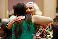 USA International Harp Competition Founder and Artistic Director Susann McDonald shares a hug during the opening reception and dinner of the 11th USA International Harp Competition at Indiana University in Bloomington, Indiana on Wednesday, July 3, 2019. (Photo by James Brosher)