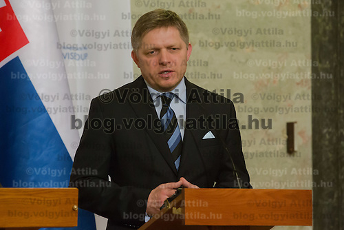 Robert Fico (R) Prime Minister of Slovakia talks during a press conference after the special meeting of the prime ministers of the Visegrad 4 Group in Budapest, Hungary on January 29, 2014. ATTILA VOLGYI