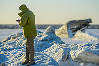 A man walks along the frozen Delaware Bay near the SS Atlantus sunken ship Friday, January 05, 2018 in Cape May Point, New Jersey. (Photo by William Thomas Cain/Cain Images)