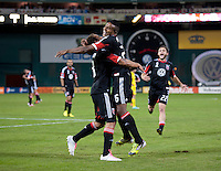 Nick DeLeon (18) of D.C. United celebrates his goal with teammate Lionard Pajoy (26) during the game at RFK Stadium in Washington, DC.  D.C. United defeated the Columbus Crew, 3-2.