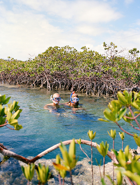 SOUTH ANDROS ISLAND, THE BAHAMAS : A couple enjoys a day of snorkeling at The Crack. South Andros,The Bahamas.