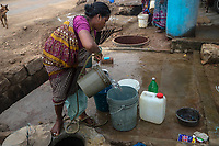 A woman fills a bucket outside her house in village Gorikothapally, Telangana, Indiia, on Friday, February 8, 2019. Photographer: Suzanne Lee for Safe Water Network