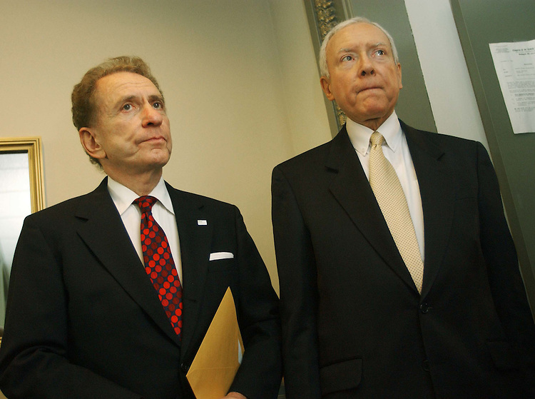 "11/18/04.SPECTER SUPPORT--Sen. Arlen Specter, R-Pa., and outgoing Chairman Orrin G. Hatch, R-Utah, wait for other senators for a news conference in which Senate Judiciary Republicans announced their unanimous support for Specter as their next chairman..From CQ.com: ""We are definitely supporting Arlen Specter for this position,"" said Orrin G. Hatch, R-Utah, who is being forced by six-year GOP term limits to relinquish the chairmanship. ""He will be the chairman of the Senate Judiciary Committee."".Social conservatives have bombarded Senate Republicans with demands that they block Specter from becoming chairman ever since he said Nov. 3 that President Bush would have a difficult time winning confirmation of any Supreme Court nominee who was eager to overturn the landmark 1973 Roe v. Wade decision legalizing abortion nationwide..Though the actual chairmanship vote will not take place until the new Congress convenes in January, Thursday's announcement appears to assure that Specter will survive the conservative onslaught. Committee Republicans have the first vote on the chairmanship, and their recommendation must then be approved by a majority of the 55 Republicans who will serve in the 109th Congress..Flanked by his fellow committee Republicans, Specter read a statement in which he said, ""I have not and would not use a litmus test to confirm nominees."".CONGRESSIONAL QUARTERLY PHOTO BY SCOTT J. FERRELL"