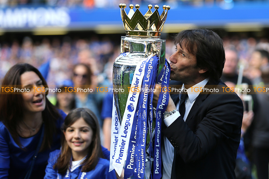 Chelsea Manager, Antonio Conte, kisses the Premier League Trophy as his wife, Elisabetta Muscarello and daughter, Vittoria, look on during Chelsea vs Sunderland AFC, Premier League Football at Stamford Bridge on 21st May 2017