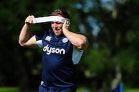 Henry Thomas of Bath Rugby applies strapping. Bath Rugby pre-season training session on August 9, 2016 at Farleigh House in Bath, England. Photo by: Patrick Khachfe / Onside Images