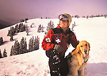 Vail Mountain's Avalanche Rescue Dog, Henry, a Labroador, with  a trainer, Vail ski patroman Ben Kurtz, above the famed back bowls on Vail mountain.