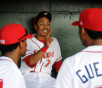 Infielder Mookie Betts (7) of the Greenville Drive talks with teammates in the dugout prior to a game against the West Virginia Power on Tuesday, April 16, 2013, at Fluor Field at the West End in Greenville, South Carolina. West Virginia won, 8-3. (Tom Priddy/Four Seam Images)