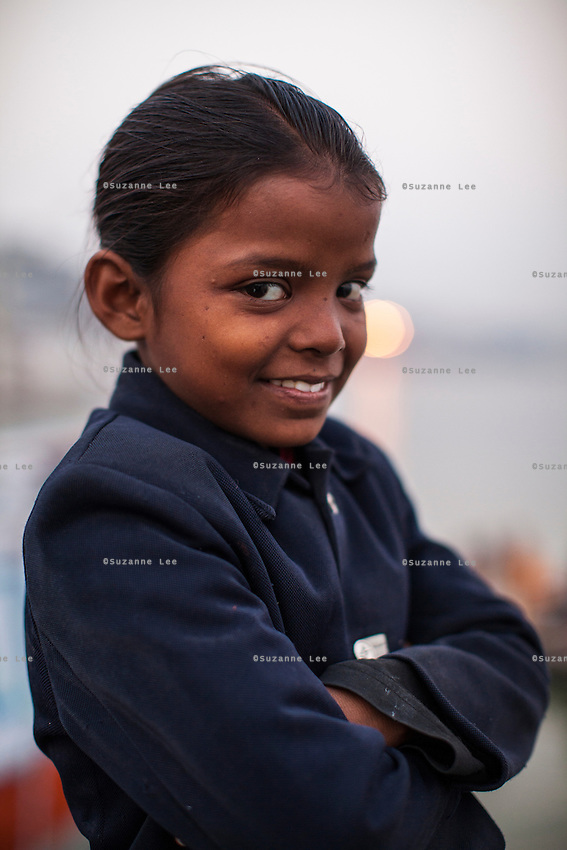 Gudia, 9, poses for a portrait on the Boat School Guria runs on the holy Ganges River, in Varanasi, Uttar Pradesh, India on 19 November 2013. The school, accommodating almost 50 children, aims to take the boatmen's children away from working in the tourist areas where they are exposed to trafficking and sexual abuse.
