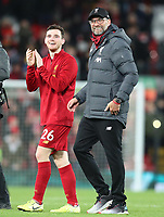 2nd January 2020; Anfield, Liverpool, Merseyside, England; English Premier League Football, Liverpool versus Sheffield United; Andy Robertson of Liverpool and Liverpool manager Jurgen Klopp smile as they walk from the pitch after Liverpool's 2-0 win - Strictly Editorial Use Only. No use with unauthorized audio, video, data, fixture lists, club/league logos or 'live' services. Online in-match use limited to 120 images, no video emulation. No use in betting, games or single club/league/player publications