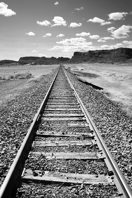 train tracks disappearing into the desert landscape, moab, southeastern utah, contrast the vast desert landscape