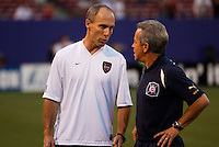 MetroStars' coach Bob Bradley talks with his counterpart Chicago Fire coach Dave Sarachan before the start of the game. The Chicago Fire played the NY/NJ MetroStars to a one all tie at Giant's Stadium, East Rutherford, NJ, on May 15, 2004.