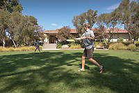 Ian Van Dusen '20 (tan shirt) and Greg Kleinman '20 (blue shirt) play catch with a frisbee in the Mullin Grove at the main entrance to Occidental College, Sept. 27, 2016.<br /> (Photo by Marc Campos, Occidental College Photographer)