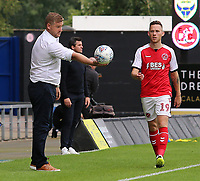 Oxford United Manager Karl Robinson holds the ball out for Fleetwood Town's Gethin Jones<br /> <br /> Photographer David Shipman/CameraSport<br /> <br /> The EFL Sky Bet League One - Oxford United v Fleetwood Town - Saturday August 11th 2018 - Kassam Stadium - Oxford<br /> <br /> World Copyright &copy; 2018 CameraSport. All rights reserved. 43 Linden Ave. Countesthorpe. Leicester. England. LE8 5PG - Tel: +44 (0) 116 277 4147 - admin@camerasport.com - www.camerasport.com