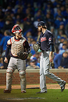 Cleveland Indians pitcher Andrew Miller (24) talks with catcher Roberto Perez after the 7th inning in the seventh inning during Game 4 of the Major League Baseball World Series against the Chicago Cubs on October 29, 2016 at Wrigley Field in Chicago, Illinois.  (Mike Janes/Four Seam Images)