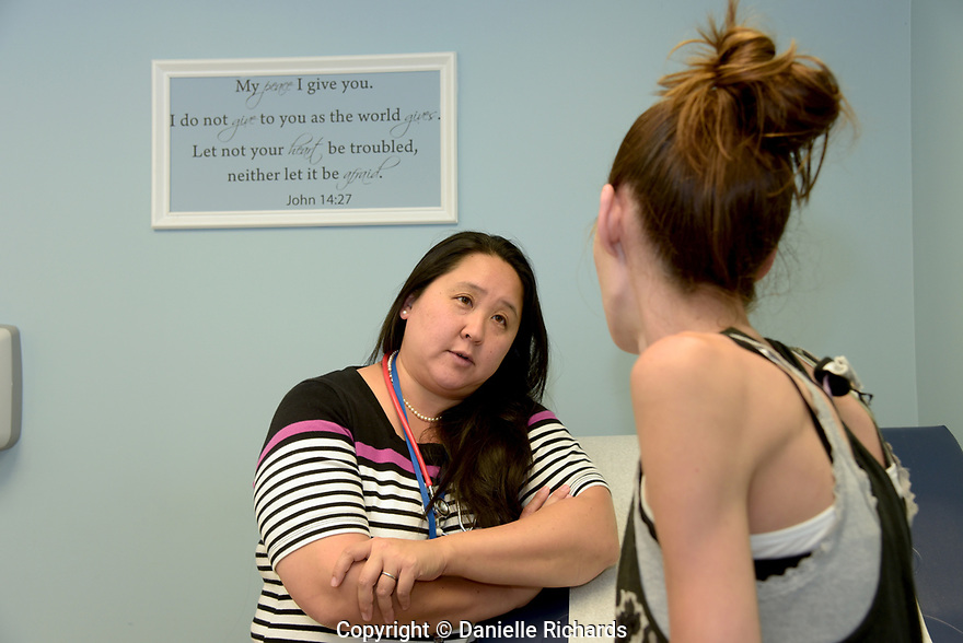 Dr. Janet Kim started the Beacon Christian Community Health Center with her husband at the suggestion of a church friend. Quotes from scripture are on the walls in all of the exam rooms.