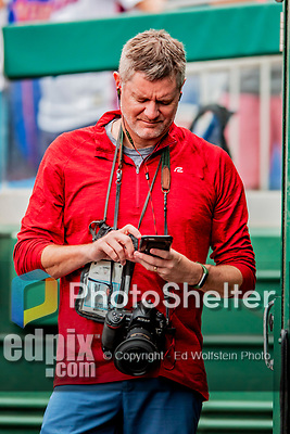 22 September 2018: Photographer Brad Mills checks messages on his smartphone prior to a game between the Washington Nationals and the New York Mets at Nationals Park in Washington, DC. The Nationals shut out the Mets 6-0 in the 3rd game of their 4-game series. Mandatory Credit: Ed Wolfstein Photo *** RAW (NEF) Image File Available ***