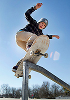 NWA Democrat-Gazette/DAVID GOTTSCHALK Ethan Adams, 12, practices Thursday, January 4, 2018, a 180 degree spin off of a front board slide on one of the features at the skateboard park at Walker Park in Fayetteville.Walker Park was the second park added to the city parks system in 1949.
