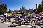 Cyclists speeding past British Columbia Legislature building. Robert Cameron Law Cycling Series, bike race event in Victoria, BC, Canada 2017
