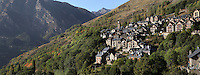 Panoramic view of the village of Taull against the massive slopes of the Pyrenees mountains, Province of Lleida, Catalonia, Spain. In the distance, at the far end of the village, the campanile of Santa Maria de Taull church is visible. Picture by Manuel Cohen.