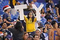 "20 December 2011:  An FIU fan holds up the letters ""T"" and ""Y"" to cheer on the team's star, T.Y. Hilton, prior to the game.  The Marshall University Thundering Herd defeated the FIU Golden Panthers, 20-10, to win the Beef 'O'Brady's St. Petersburg Bowl at Tropicana Field in St. Petersburg, Florida."