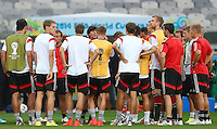 Germany coach Joachim Loew talks to his players during training ahead of tomorrow's semi final vs Brazil