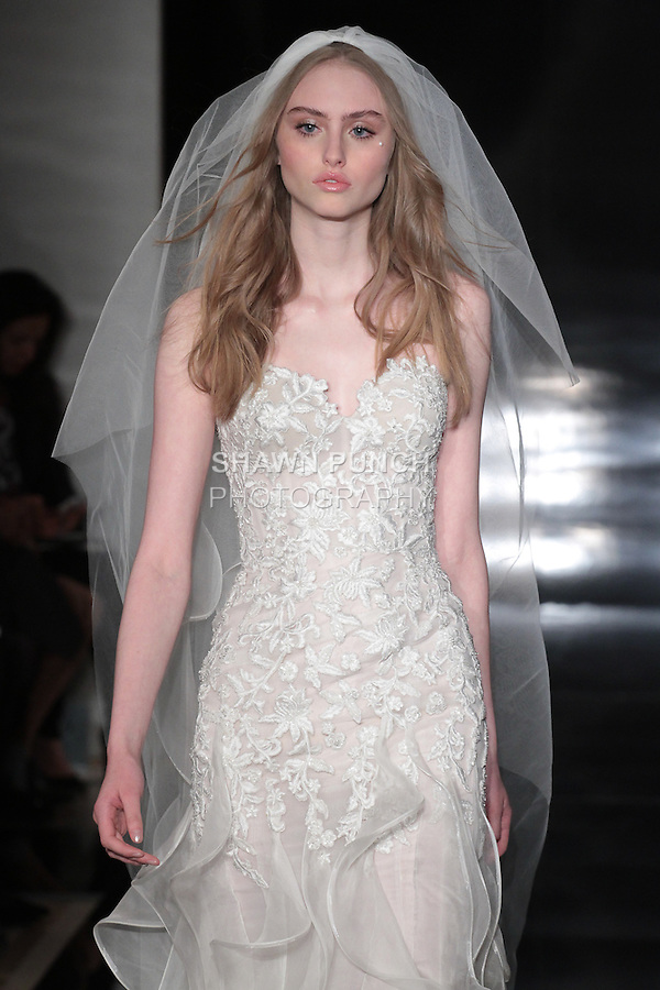 Model walks runway in a strapless embroidered sweetheart gown with layered organza skirt and matching veil, from the Reem Acra Spring 2017 bridal collection, during New York Bridal Fashion Week Spring Summer 2017, on April 15, 2016.