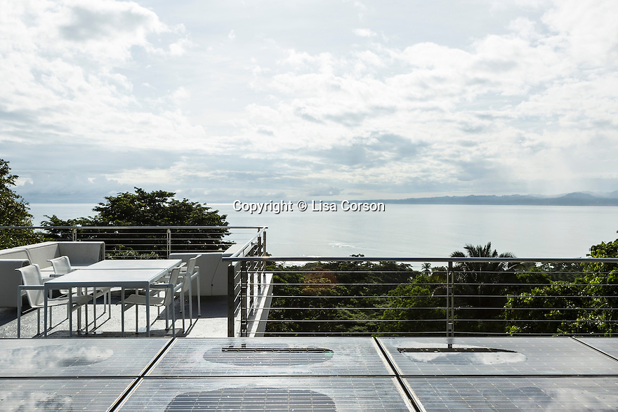 Solar panels and a seating area on the roof of Derek Ferguson's home, Casa Torcida, in Peninsula de Osa, Puntarenas, Costa Rica. CREDIT: Lisa Corson for The Wall Street Journal     SLUG: OFFGRID-Costa Rica Images are available for editorial licensing, either directly or through Gallery Stock. Some images are available for commercial licensing. Please contact lisa@lisacorsonphotography.com for more information.