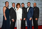 Reba McEntire arrives with her family for the formal Artist's Dinner honoring the recipients of the 41st Annual Kennedy Center Honors hosted by United States Deputy Secretary of State John J. Sullivan at the US Department of State in Washington, D.C. on Saturday, December 1, 2018. Pictured from left to right: Marne McLyman, Skeeter Lasuzzo, Reba McEntire, Shelby Blackstock, Justin McIntosh, and Brett Freedman.  The 2018 honorees are: singer and actress Cher; composer and pianist Philip Glass; Country music entertainer Reba McEntire; and jazz saxophonist and composer Wayne Shorter. This year, the co-creators of Hamilton,  writer and actor Lin-Manuel Miranda, director Thomas Kail, choreographer Andy Blankenbuehler, and music director Alex Lacamoire will receive a unique Kennedy Center Honors as trailblazing creators of a transformative work that defies category.<br /> Credit: Ron Sachs / Pool via CNP
