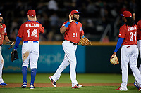 Buffalo Bisons Socrates Brito (51) high fives Alen Hanson (31) after closing out an International League game against the Norfolk Tides on June 21, 2019 at Sahlen Field in Buffalo, New York.  Buffalo defeated Norfolk 1-0, the second game of a doubleheader.  (Mike Janes/Four Seam Images)