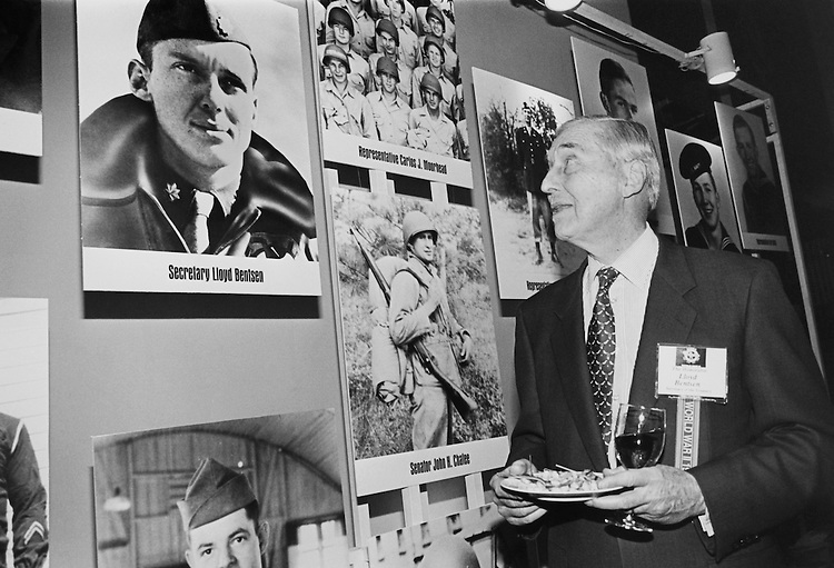 Normandy celebration at Air and Space Museum. Secretary of the Treasury Lloyd Bentsen looks up at his photo from his WWII days on May 18, 1994. (Photo by Maureen Keating/CQ Roll Call)