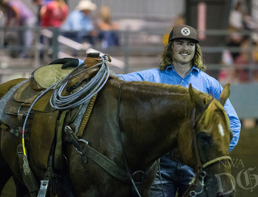 NWA Democrat-Gazette/BEN GOFF @NWABENGOFF<br />  Thursday, Aug. 8, 2019, during the team roping event during Benton County Fair in Bentonville.