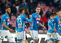 Arkadiusz Milik of Napoli  celebrates after scoring during the  italian serie a soccer match,  SSC Napoli - Frosinone       at  the San  Paolo   stadium in Naples  Italy , December 08, 2018