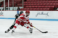 BOSTON, MA - JANUARY 11: Sammy Davis #16 of Boston University scores during a game between Providence College and Boston University at Walter Brown Arena on January 11, 2020 in Boston, Massachusetts.