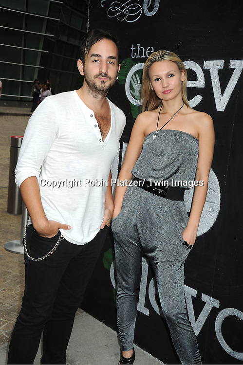 Charlie Aksun and Camilla Romestrand posing for photographers at The Olevolos Project Fundraiser Brunch at Le Cirque hosted by Bryan Greenberg on May 21, 2011 in New York.