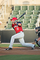 Grant DeBruin (12) of the Hagerstown Suns follows through on his swing against the Kannapolis Intimidators at CMC-Northeast Stadium on June 16, 2015 in Kannapolis, North Carolina.  The Suns defeated the Intimidators 8-4.  (Brian Westerholt/Four Seam Images)