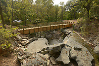 NWA Democrat-Gazette/BEN GOFF @NWABENGOFF<br /> A new bridge spans the spillway below Lake Ann on Monday Oct. 10, 2016, part of the Back 40 mountain bike trails, in Bella Vista. Parts of the new trails system are already open to riders, with a grand opening set for Oct. 15 at Blowing Springs Park, ahead of the International Mountain Bicycling Association's World Summit, which is Nov. 9-12.